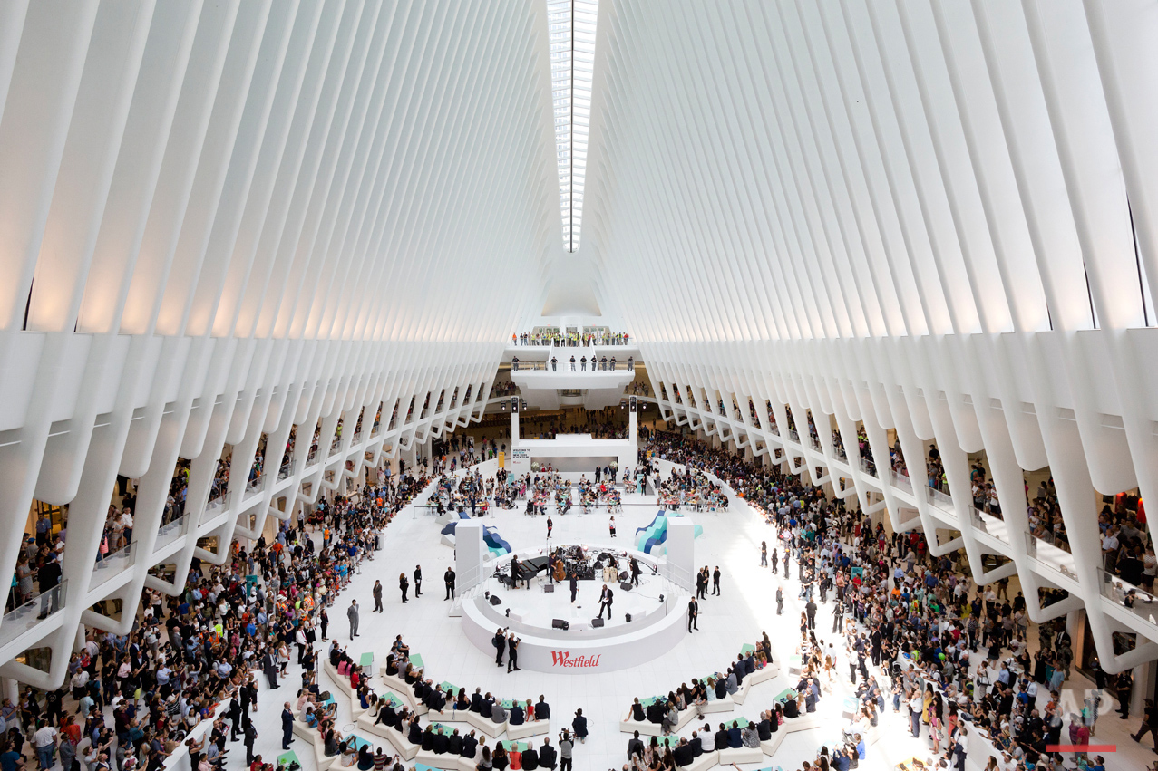 Crowds gather for a celebration for the opening of the Westfield World Trade Center mall in the oculus of the Transportation Hub, Tuesday, Aug. 16, 2016, in New York. (AP Photo/Mark Lennihan)