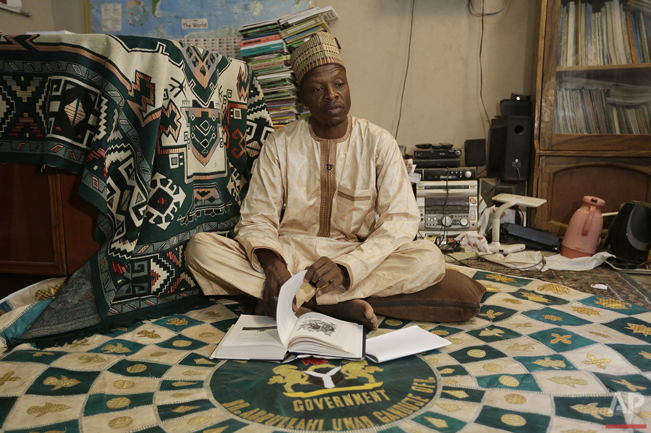 In this photo taken Sunday, April 3, 2016, Ado Ahmed Gidan Dabino, a novelist, essayist, actor and head of the Kano branch of Nigeria writers Association, during an interview in Kano, Nigeria. In the local market, stalls are signs of a feminist revolution with piles of poorly printed books by women, as part of a flourishing literary movement centered in the ancient city of Kano, that advocate against conservative Muslim traditions such as child marriage and quick divorces. (AP Photo/Sunday Alamba)