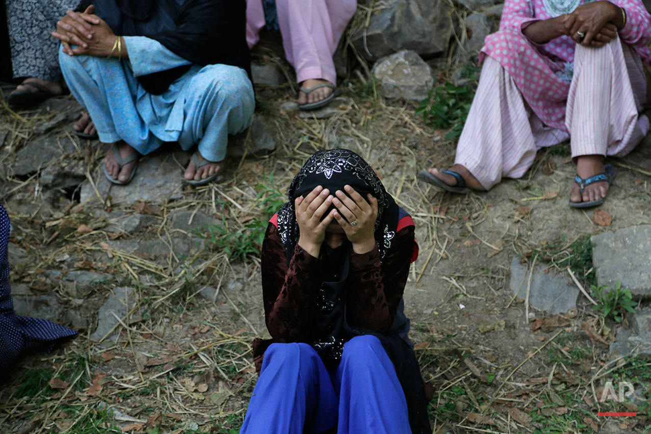 A Kashmiri woman weeps during a joint funeral of four civilians at Aripanthan village, west of Srinagar, Indian controlled Kashmir, Tuesday, Aug.16, 2016. Government forces in Indian-controlled Kashmir shot and killed four civilians and injured at least 15 others Tuesday as clashes intensified with anti-India protesters in the troubled region, police said. (AP Photo/Mukhtar Khan)