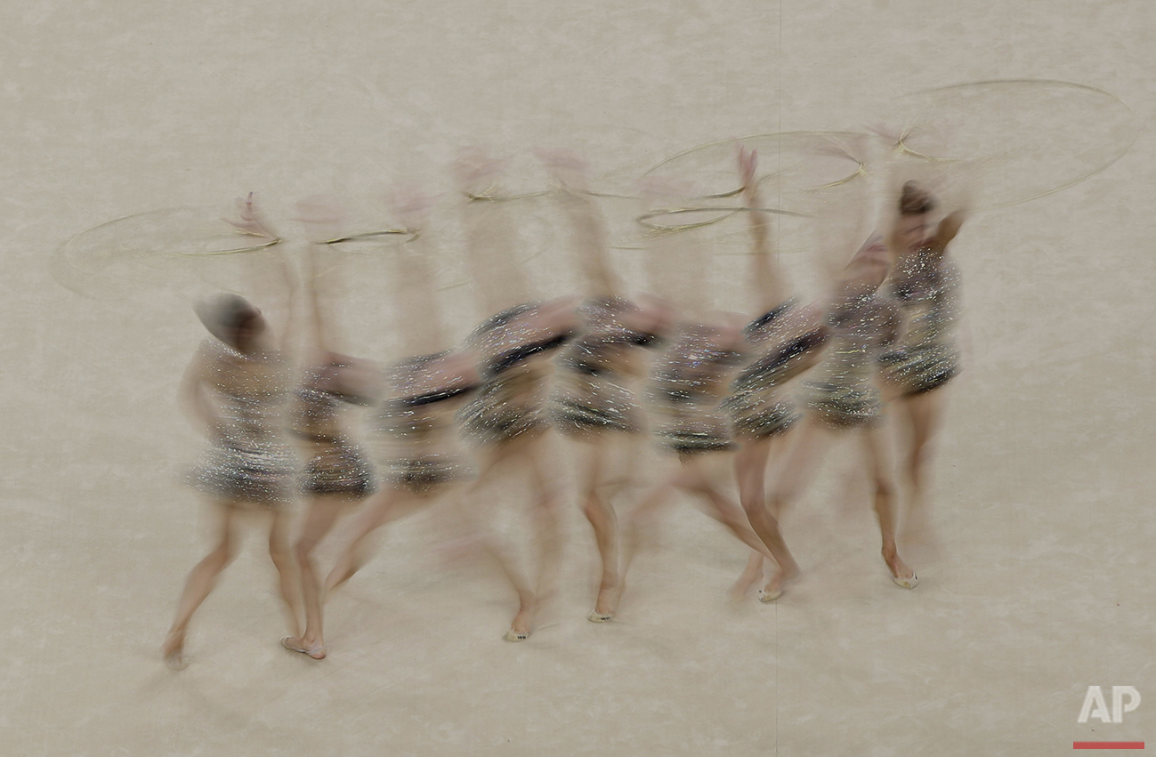 In this photo made with multiple exposures, Australia's Danielle Prince performs during the rhythmic gymnastics individual all-around qualifications at the Summer Olympics in Rio de Janeiro, Brazil, Friday, Aug. 19, 2016. (AP Photo/Julio Cortez)