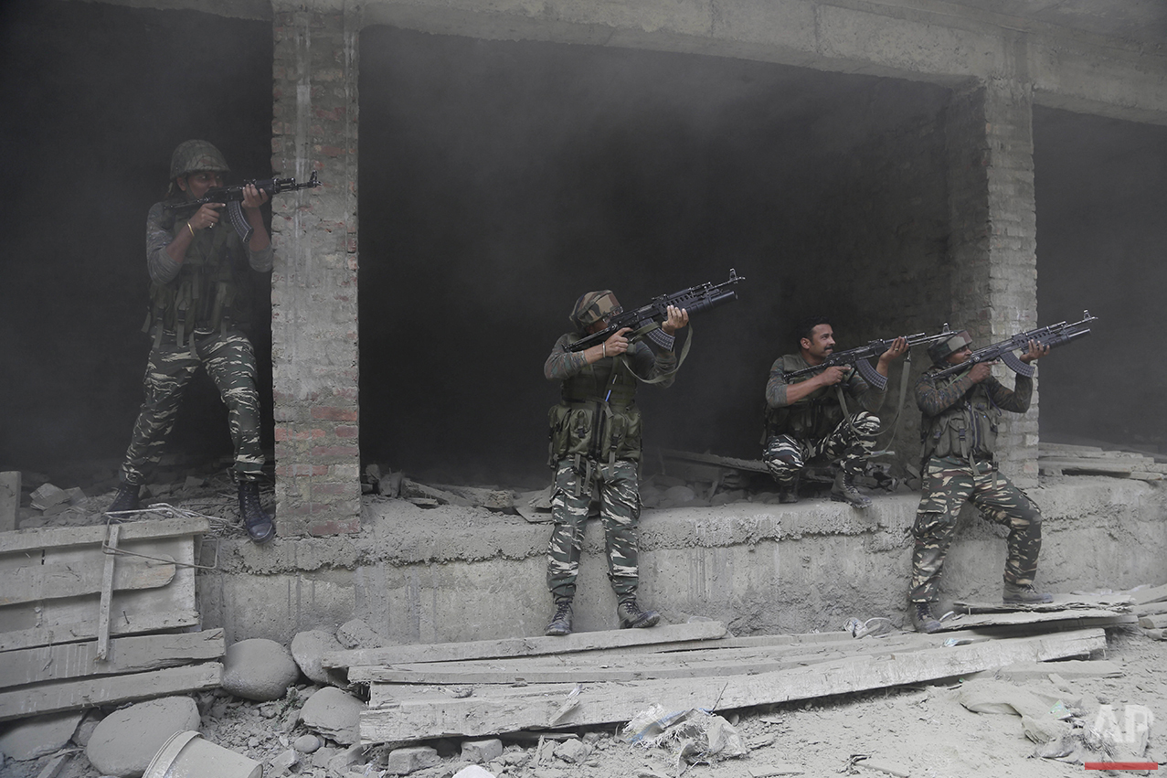 Indian paramilitary soldiers take positions near the site of a gun-battle in the Nowhatta neighborhood of Srinagar, in Indian controlled Kashmir, Monday, Aug. 15, 2016. Suspected separatist rebels and government troops were engaged in two gun battles in Indian-controlled Kashmir despite a complete security lockdown in the disputed region Monday as India celebrated its independence from British rule. (AP Photo/Mukhtar Khan)