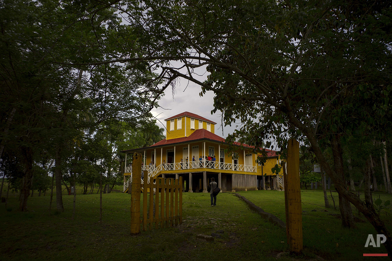 This June 10, 2016 photo shows the home-turned-museum where Fidel and Raul Castro were born and grew up in Biran, Cuba. Their father Angel planted and sold sugarcane and timber as well as raised cattle here, deep in the lush green hill country of Holguin province in eastern Cuba. (AP Photo/Ramon Espinosa)