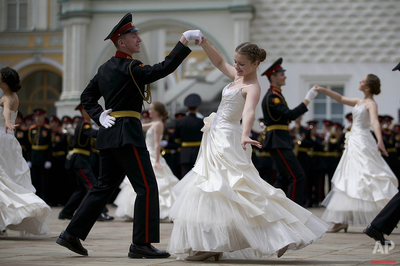 Russian cadets dance a waltz during their graduation ceremony in Moscow, on Saturday, June 25, 2016. After giving the oath to the Russian flag, graduates of Moscow cadet schools received their diplomas during an official ceremony held inside of the Kremlin. (AP Photo/Ivan Sekretarev)