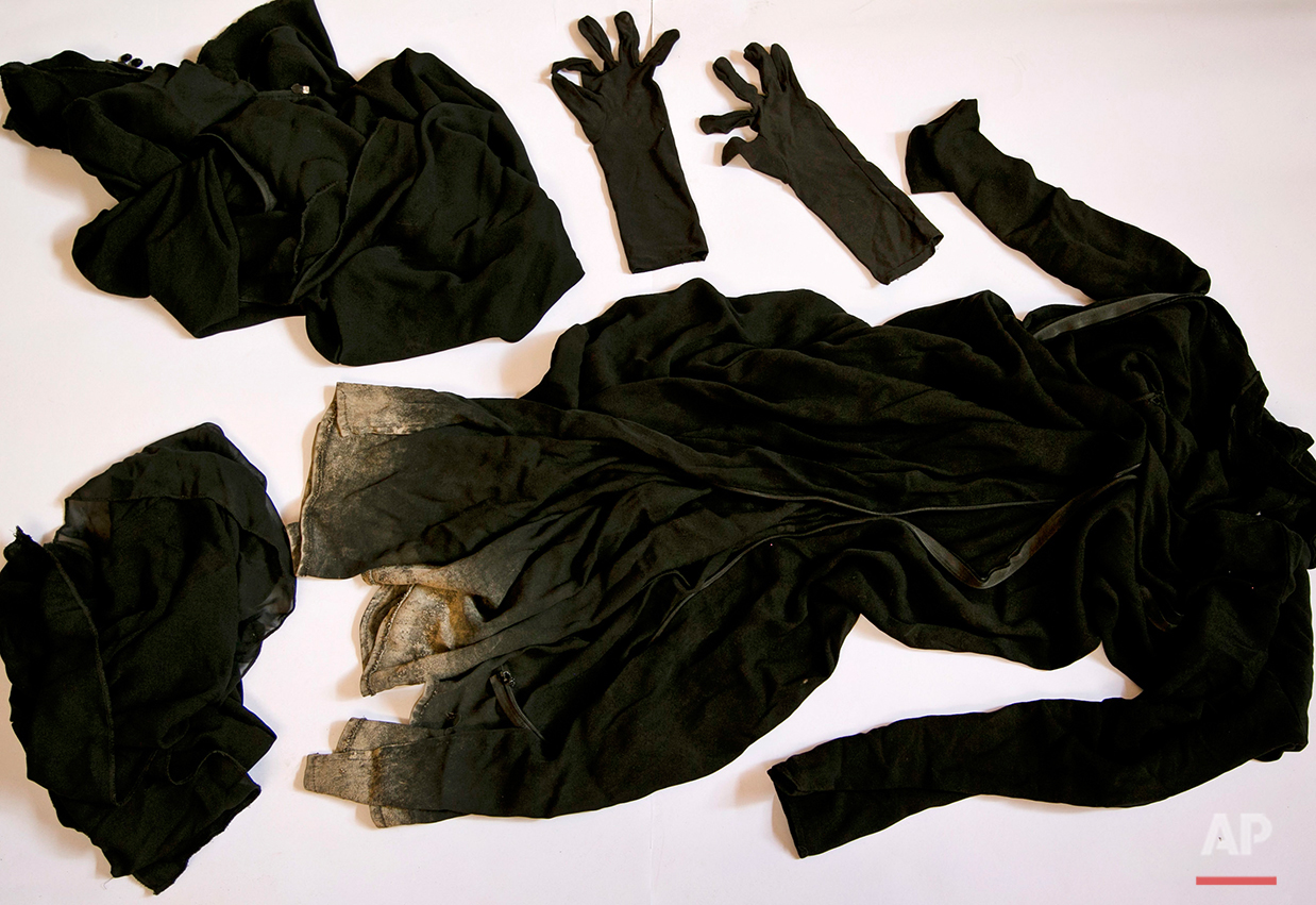 Clothing worn by a Yazidi girl enslaved by Islamic State militants, collected by a Yazidi activist to document Islamic State group crimes against the community, shown in this file photo taken May 22, 2016, in Dohuk, northern Iraq. The militants are tightening their grip on the estimated 3,000 Yazidi girls and women they hold as sex slaves, creating a database to identify them so they can't sneak away and assassinating smugglers who have tried to help rescue them. (AP Photo/Maya Alleruzzo)