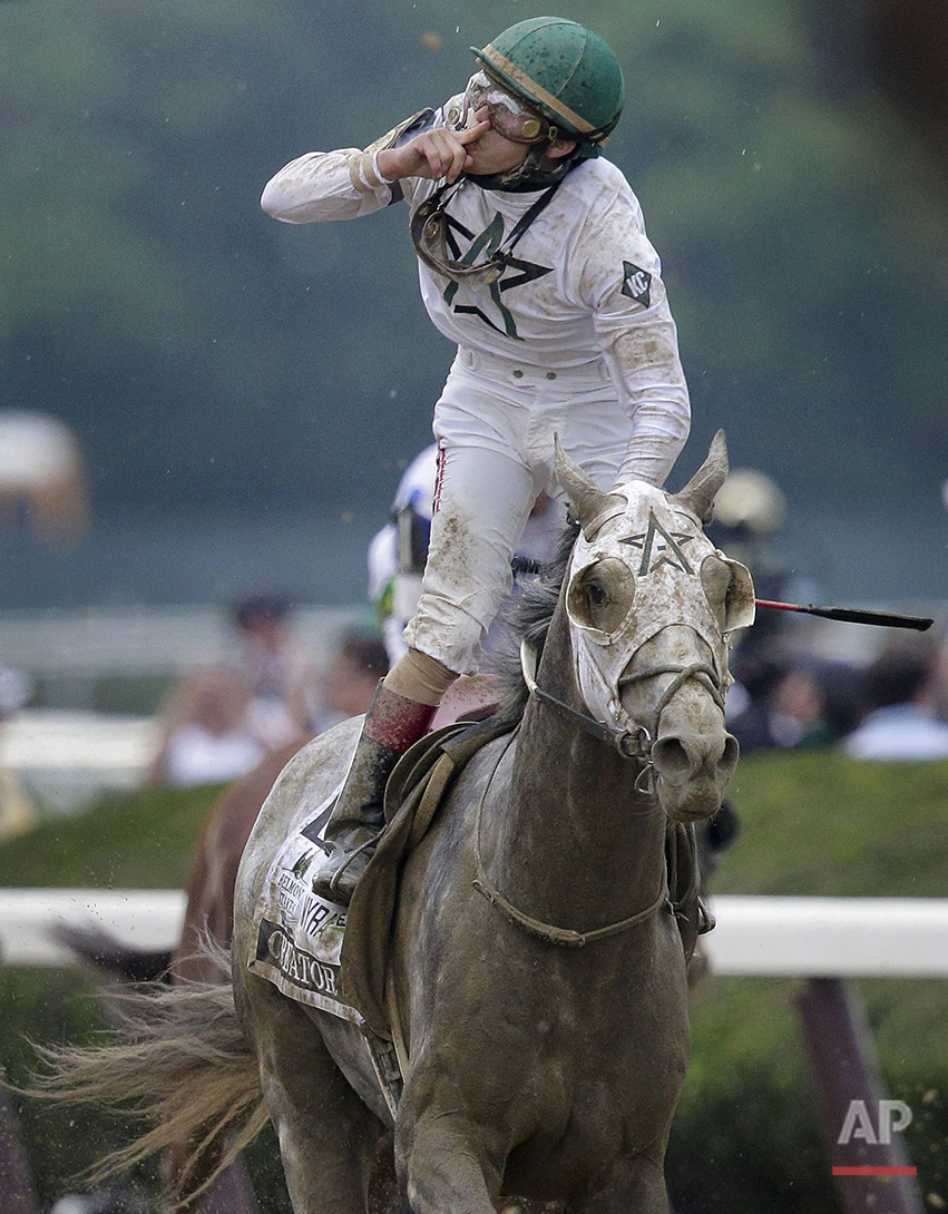Jockey Irad Ortiz Jr., riding Creator, celebrates after winning the 148th running of the Belmont Stakes horse race, Saturday, June 11, 2016, in Elmont, N.Y. (AP Photo/Peter Morgan)