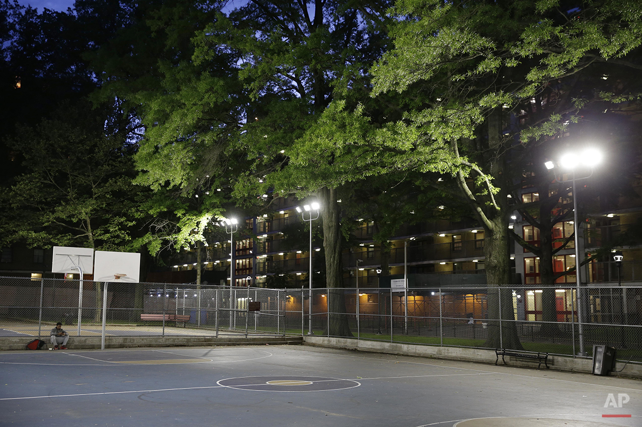 Lights illuminate a basketball court at the Stapleton Houses low-income housing complex in the Staten Island borough of New York, Wednesday, June 8, 2016. (AP Photo/Seth Wenig)