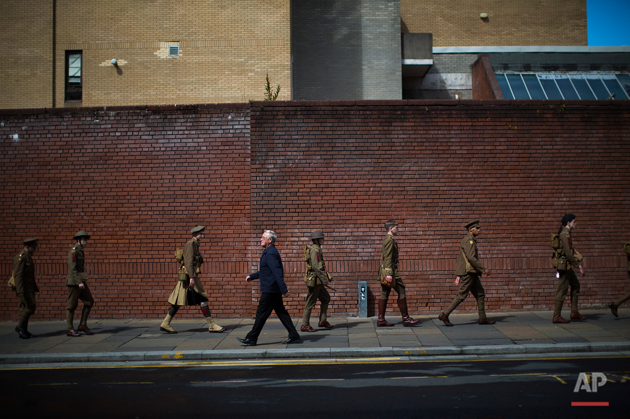 In this Saturday, July 2, 2016 photo, men wearing World War I era uniforms march in downtown Glasgow, as they commemorate the 100th anniversary of the Battle of the Somme.  (AP Photo/Emilio Morenatti)