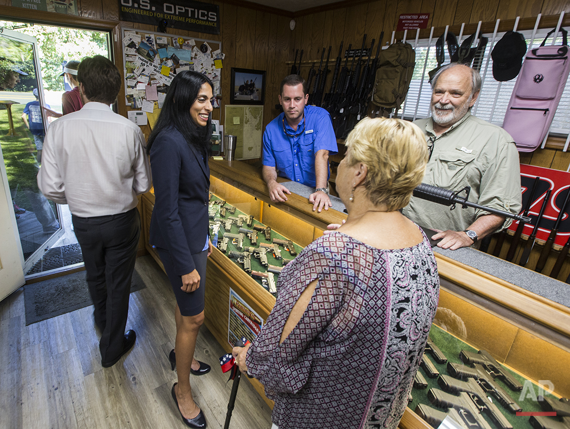 Republican candidate for Florida's Second Congressional District Mary Thomas, right, talks to supporters at DSH Firearms in Tallahassee, Fla., on July 19, 2016. As a conservative, she is an opponent of abortion and Obamacare. The general counsel of Florida's Department of Elder Affairs is running to become the first Indian-American woman in Congress. (AP Photo/Mark Wallheiser)