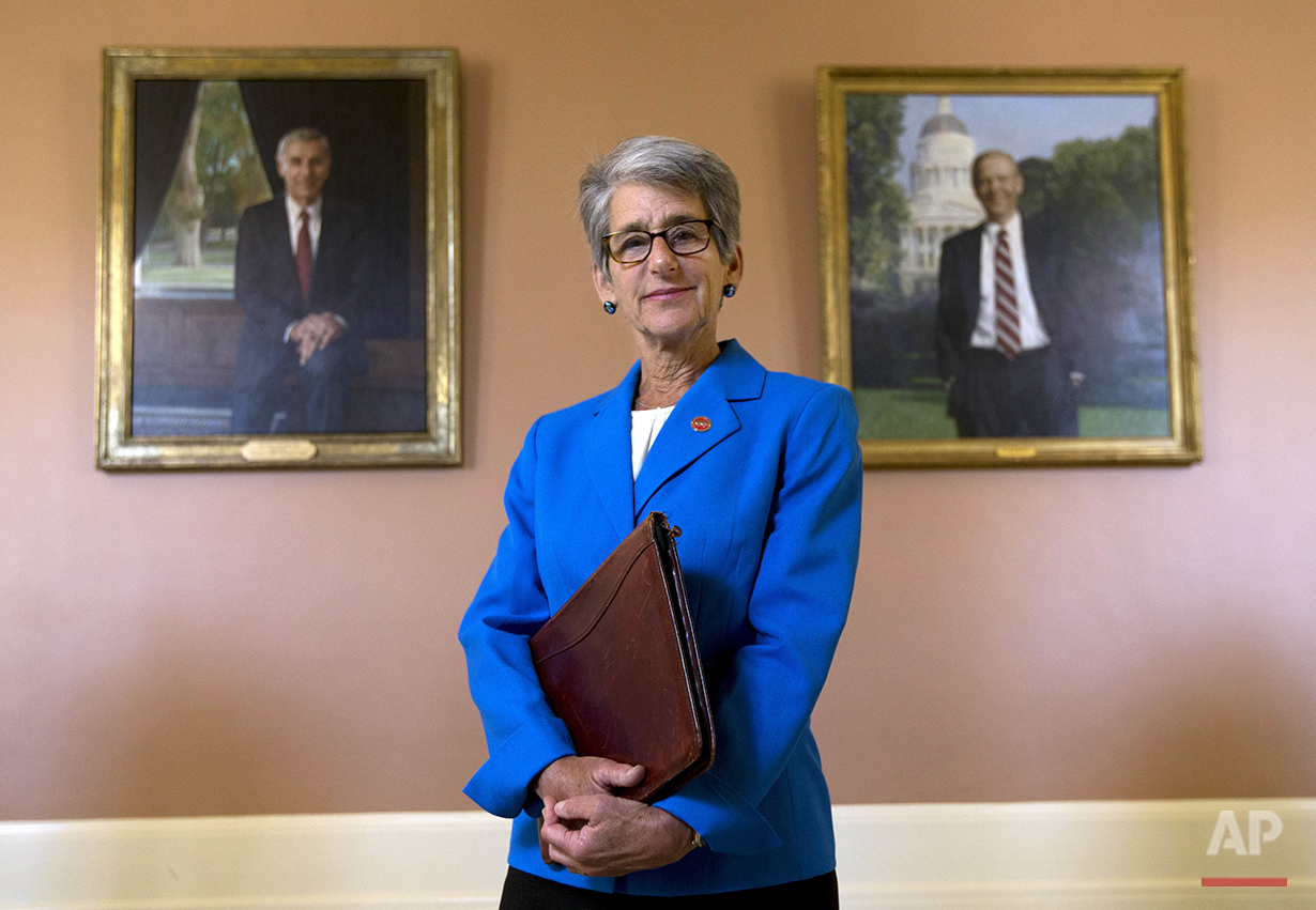 "California state Sen. Hannah-Beth Jackson, D-Santa Barbara, poses in front of portraits of two former California governors, Republicans George Deukmejian, left and Pete Wilson, at the Capitol in Sacramento, Calif., on Wednesday, June 29, 2016. Jackson had long been active in her community beyond her work as a lawyer and former prosecutor, but it took the encouragement of one of her mentors to convince her to run for state Assembly in 1998. ""Women tend to ask permission, and we're never quite sure we are good enough or ready enough,"" she said. ""Men generally don't have those same concerns."" (AP Photo/Rich Pedroncelli)"