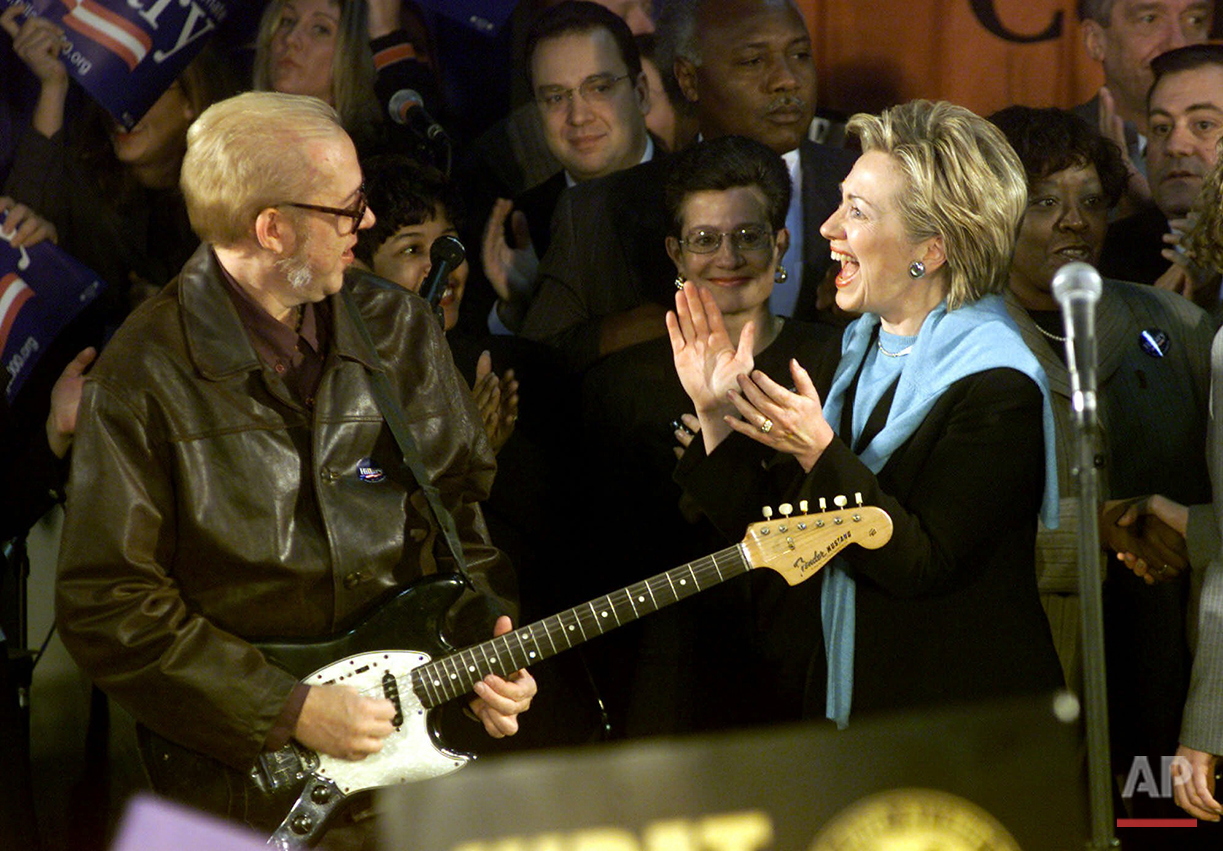 In this Nov. 6, 2000 photo, then-U.S. Senate candidate first lady Hillary Rodham Clinton meets Rob Buck of the 10,000 Maniacs during a campaign stop in Buffalo, N.Y. No other first lady had been elected to public office when she won the 2000 election for Senate in New York. And she was the first woman to serve as a senator from New York, followed when she left office by the second, Kirsten Gillibrand. (AP Photo/David Duprey)