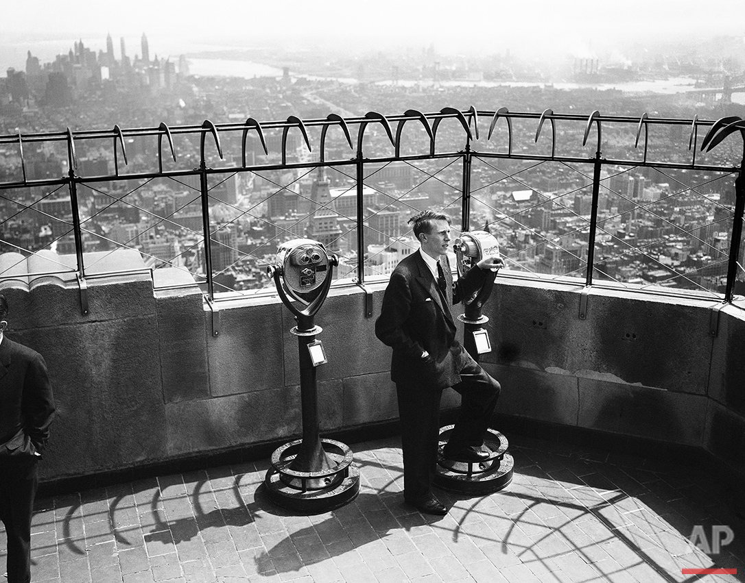 Roger Bannister, first man to pierce the mile's four-minute barrier, looks over the New York City skyline from atop the Empire State Building on May 13, 1954. Bannister, 25-year-old British medical student, ran the mile in 3:59.4 at Oxford, England, last week. (AP Photo/AC)