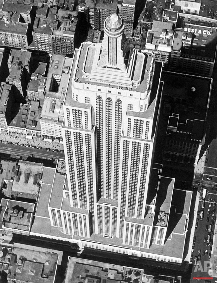 When seen from the air, this monarch of all the world's large buildings, the Empire State Building, located on Fifth Avenue in New York, scarcely looks its full height of 1250 feet, on Sept. 12, 1938. The Empire State has 102 floors, the last 16 being in the observation tower. (AP Photo)