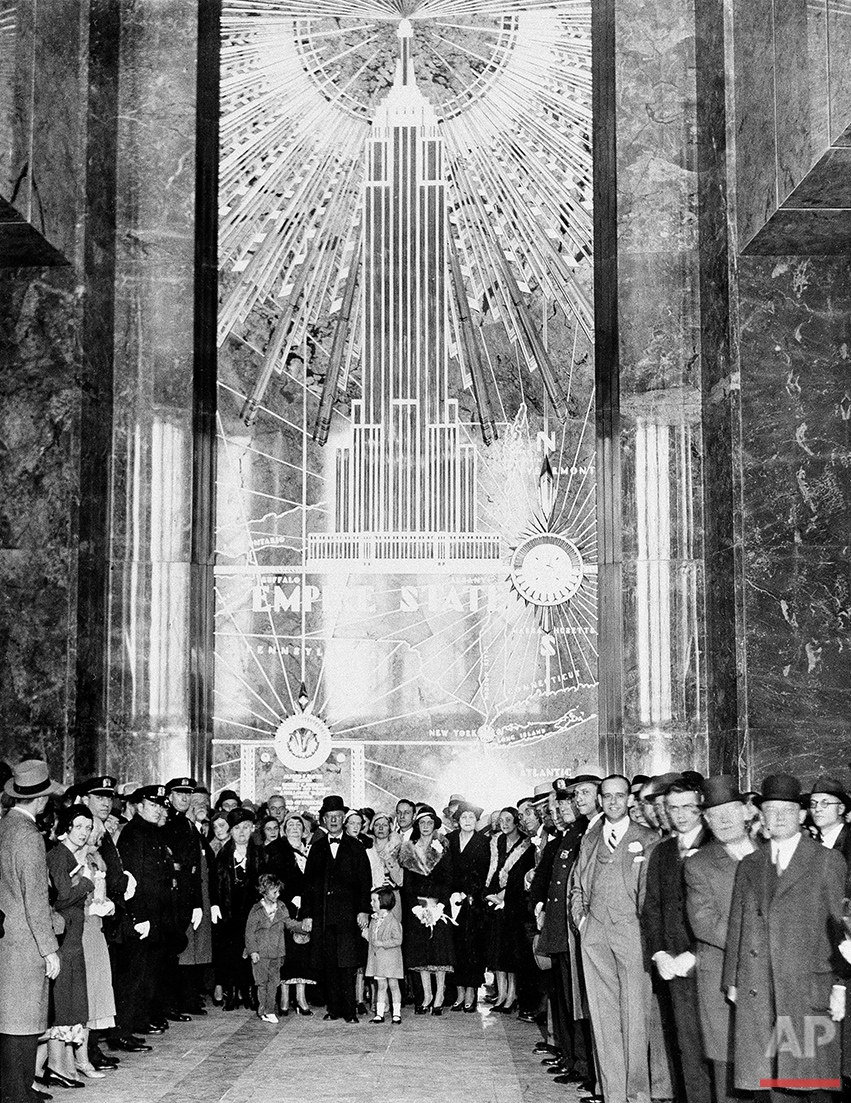 A general view in the lobby of the Empire State Building, May 1, 1931. Former Gov. Alfred E. Smith, with his grandchildren and party, are shown as they awaited the illumination of the building which was caused by the pushing of a button by President Hoover in Washington, D.C. This act officially opened the new building. (AP Photo)