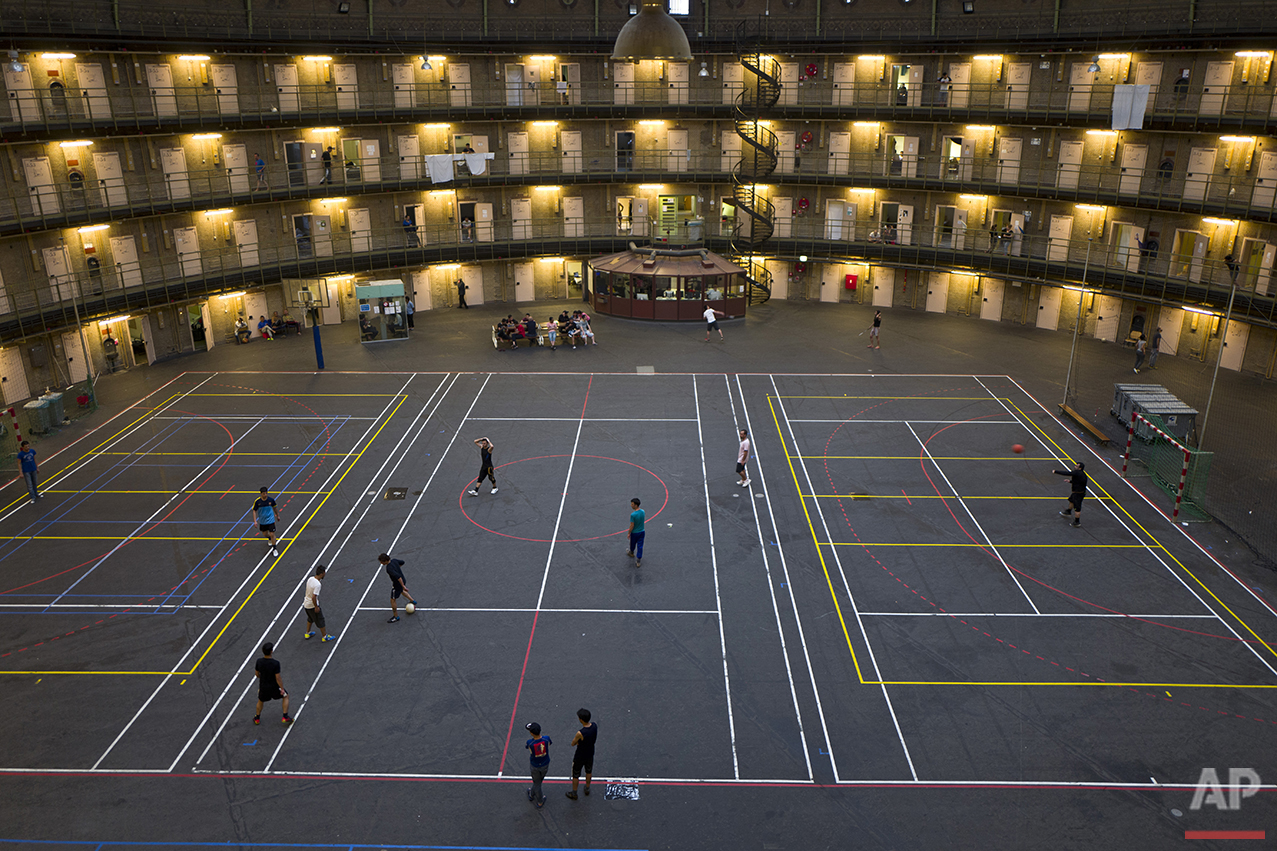 In this Tuesday, May 10, 2016 photo, refugees and migrants play football at the former prison of De Koepel in Haarlem, Netherlands. (AP Photo/Muhammed Muheisen)