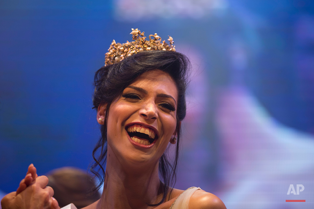 Israeli Arab Talleen Abu Hanna, 21, reacts as she was announced as the first Miss Trans Israel beauty pageant, at HaBima, Israel's national theater in Tel Aviv, Israel, Friday, May 27, 2016. Abu Hanna, an Israeli from a Catholic Arab family has been crowned the winner of the country's first transgender pageant. (AP Photo/Oded Balilty)