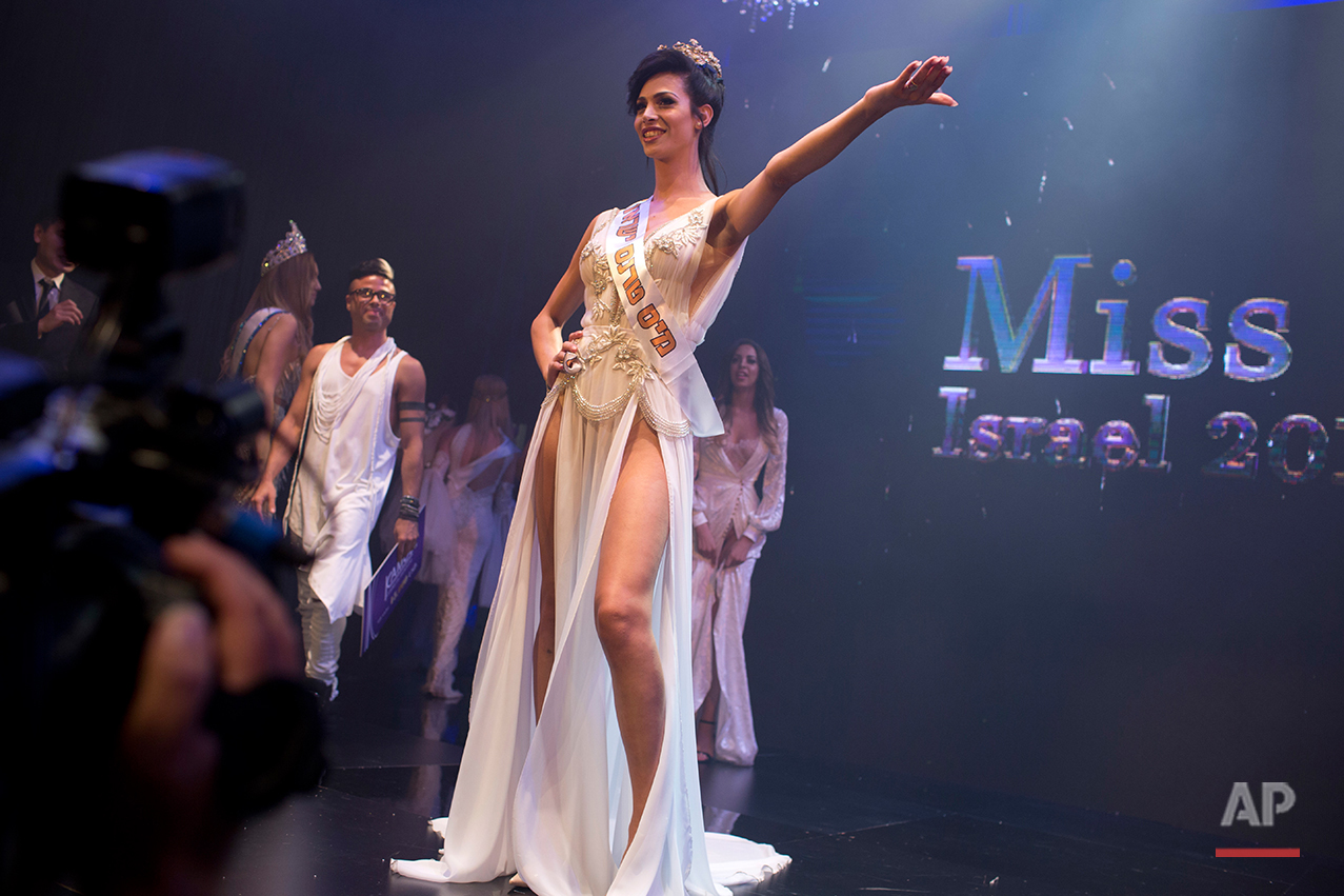 Israeli Arab Talleen Abu Hanna, 21, poses on stage after she was announced as the first Miss Trans Israel beauty pageant, at HaBima, Israel's national theater in Tel Aviv, Israel, Friday, May 27, 2016. Abu Hanna, an Israeli from a Catholic Arab family has been crowned the winner of the country's first transgender pageant. (AP Photo/Oded Balilty)