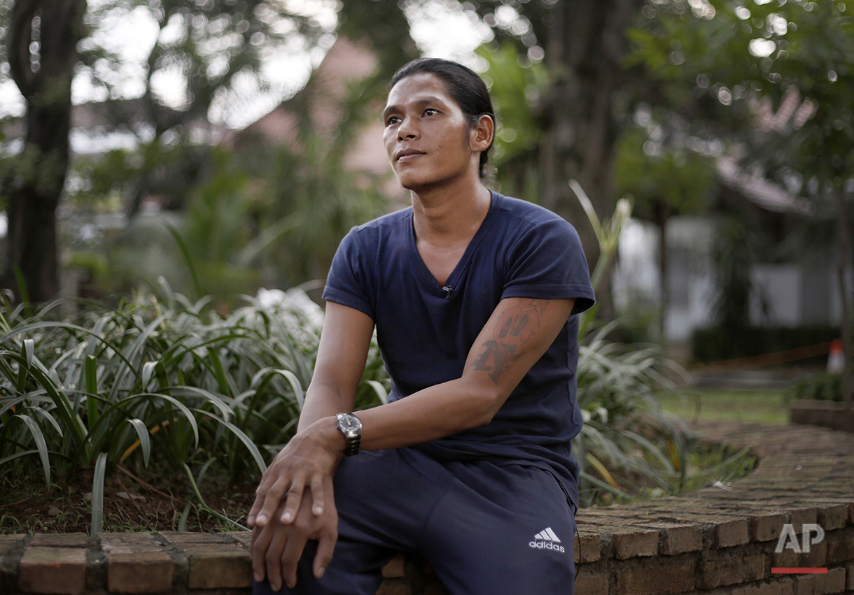 In this Monday, April 6, 2015 photo, former fishing slave Kyaw Naing pauses during an interview with the Associated Press in Jakarta, Indonesia. Kyaw Naing, who was at one point kept in a cage on the remote island of Benjina, is among eight migrant fishermen rescued for their safety in the course of an Associated Press investigation into slavery in the seafood industry. Hundreds of others evacuated by the Indonesian government after the story are waiting to be repatriated. (AP Photo/Dita Alangkara)