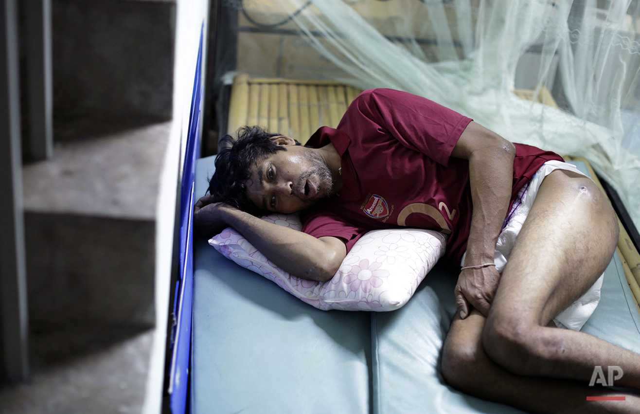 In this Friday, Dec. 12, 2014 photo, Min Min, from Myanmar, rests on a make-shift bed. Min Min was rescued from a tiny island two months ago, on the verge of starvation, and brought back to Thailand, the world's third-largest seafood exporter. Concerns about labor abuses, especially at sea, prompted the U.S. State Department last year to downgrade Thailand to the lowest level in its annual human trafficking report, putting the country on par with North Korea, Iran and Syria.(AP Photo/Wong Maye-E)