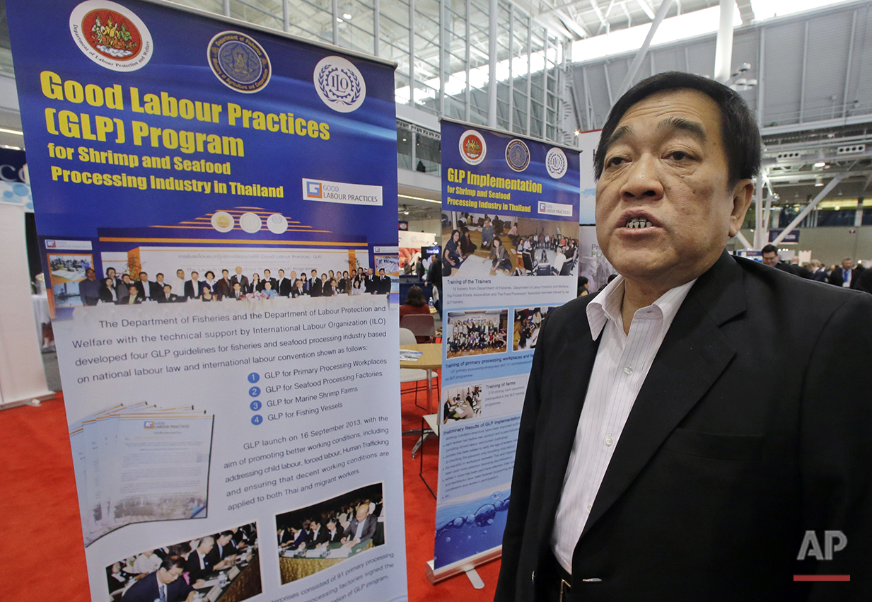 """In this Monday, March 16, 2015 photo, Thai Frozen Foods Association President Dr. Poj Aramwattananont speaks during an interview at the Seafood Expo in Boston. He said Thais know that human trafficking is wrong, but Thai companies cannot always track down the origins of their fish and whether it is """"good or bad."""" (AP Photo/Elise Amendola)"""