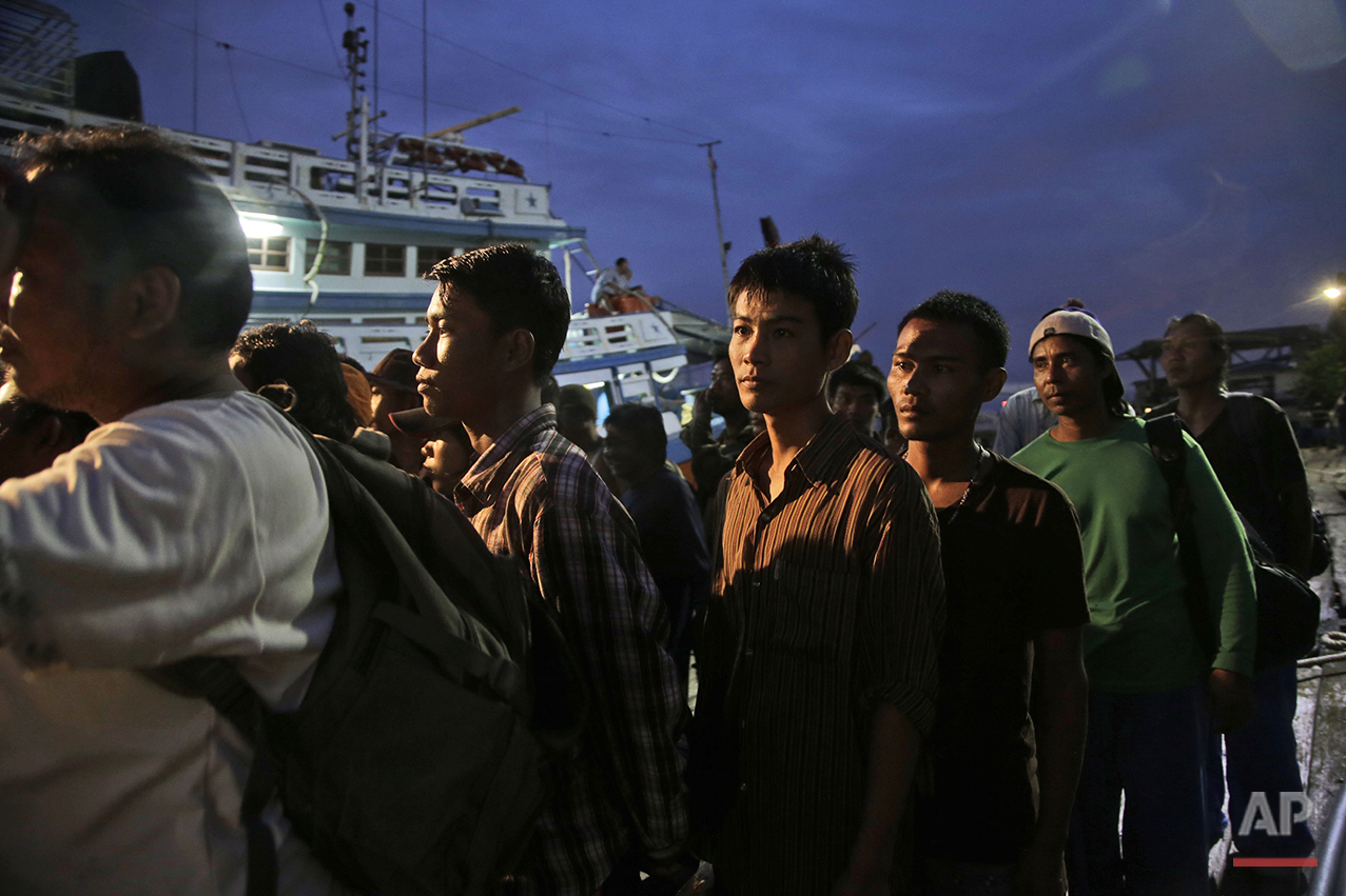 In this April 3, 2015, photo, Burmese fishermen prepare to board a boat during a rescue operation at the compound of Pusaka Benjina Resources fishing company in Benjina, Aru Islands, Indonesia. On Thursday, March 10, 2016, five Thai fishing boat captains and three Indonesians were sentenced to three years in jail for human trafficking in connection with slavery in the seafood industry. The suspects were arrested in the remote island village of Benjina in May 2015 after the abuse was revealed by The Associated Press in a report two months earlier. (AP Photo/Dita Alangkara)