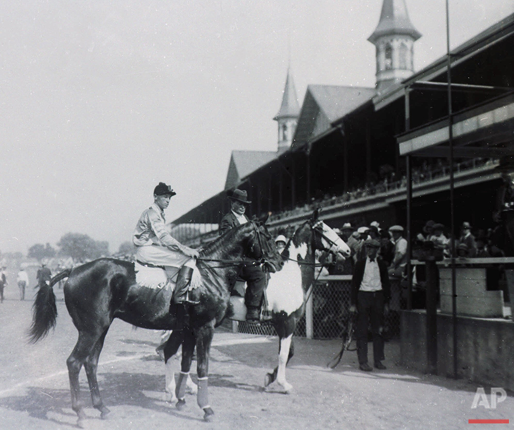 Black Gold is lead to the winner's circle after capturing the 50th Kentucky at Churchill Downs in Louisville, Ky., on May 17, 1924. (AP Photo)