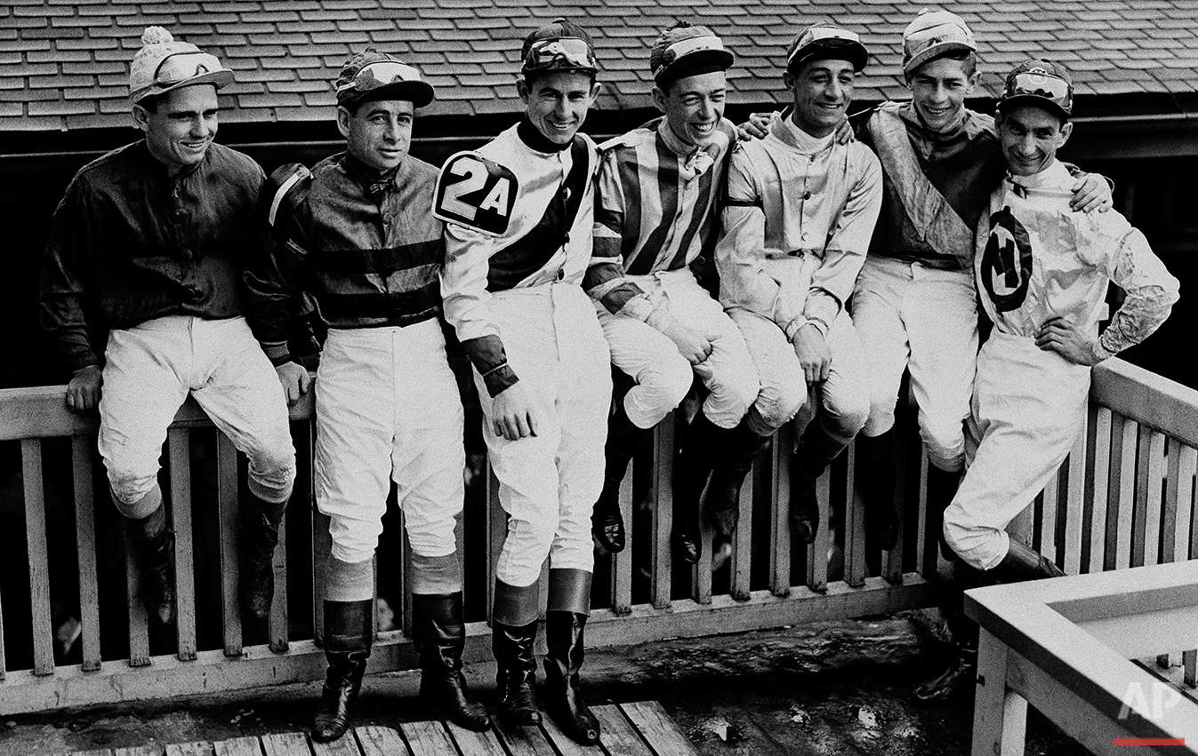 Seven of the jockeys scheduled to ride in today's Kentucky Derby sit on the rail at Churchill Downs after taking part in yesterday's Kentucky Oaks. Left to right, with horses they'll ride: Steve Brooks, Star Reward; Johny Longden, on trust; Eric Guerin, Jet Pilot; Shelby Clark, Cosmic Bomb; Eddie Arcaro, Phalanx; Job Jessop, Liberty road, and Will Balzaretti, Riskolater. (AP Photo)