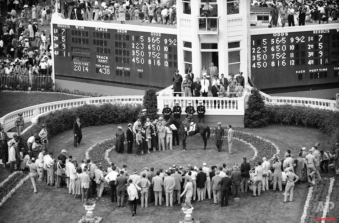Willie Shoemaker waves his cap from Swaps as he stands in winner's circle after capturing the Kentucky Derby at Churchill Downs, in Louisville, Ky., May 7, 1955. (AP Photo)