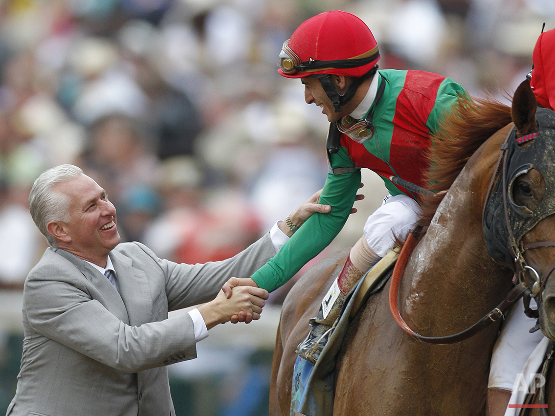 Trainer Todd Pletcher, left, congratulates John Velazquez after Velazquez rode Animal Kingdom to victory during the 137th Kentucky Derby horse race at Churchill Downs, Saturday, May 7, 2011, in Louisville, Ky. (AP Photo/Darron Cummings)