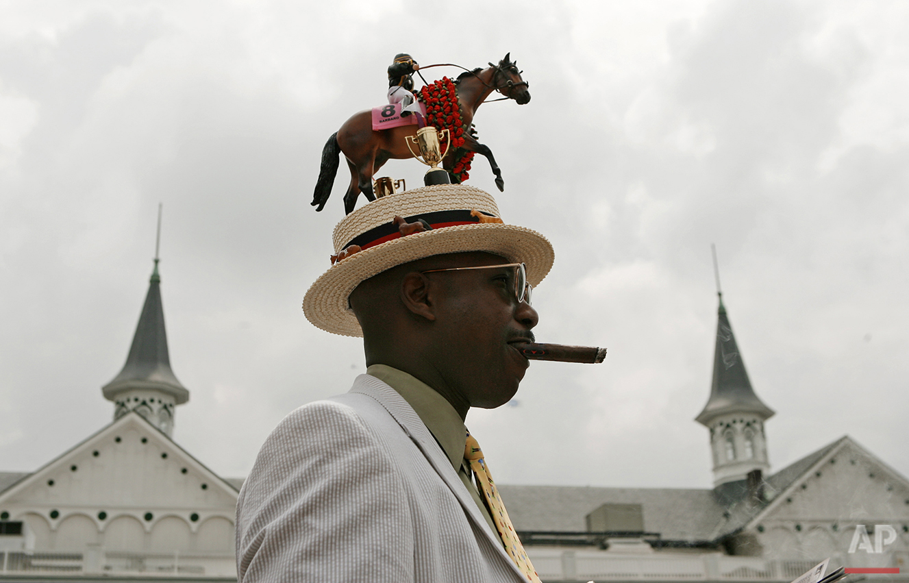 Eric Williams of Chicago wears a hat honoring last year's winner of the Kentucky Derby, Barbaro, at Churchill Downs in Louisville, Ky., Saturday, May 5, 2007. (AP Photo/Charlie Riedel)