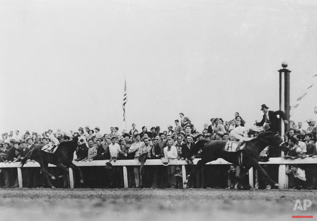 Crossing the finish line at the Kentucky Derby is Cavalcade and jockey Mack Garner, with Discovery in second place with rider John Bejshak coming up behind him, at Churchill Downs in Louisville, Ky., May 5, 1934. (AP Photo)