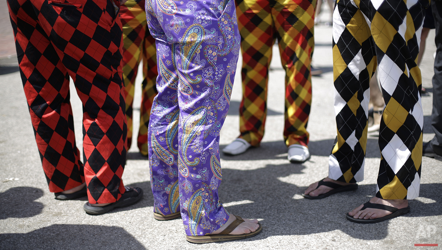 Spectators wear colorful pants before the 140th running of the Kentucky Derby horse race at Churchill Downs, Saturday, May 3, 2014, in Louisville, Ky. (AP Photo/David Goldman)