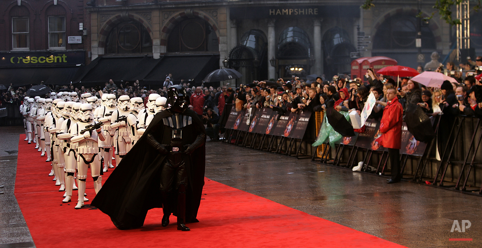 "Characters from the 'Star Wars' movies, including Darth Vader and stormtroopers, parade at the premiere of ""Star Wars Episode III, Revenge of The Sith"", at Leicester Square in London, England, Monday, May. 16, 2005. The film, by U.S. director George Lucas, is the last in the 'Star Wars' series. (AP Photo/Lefteris Pitarakis)"