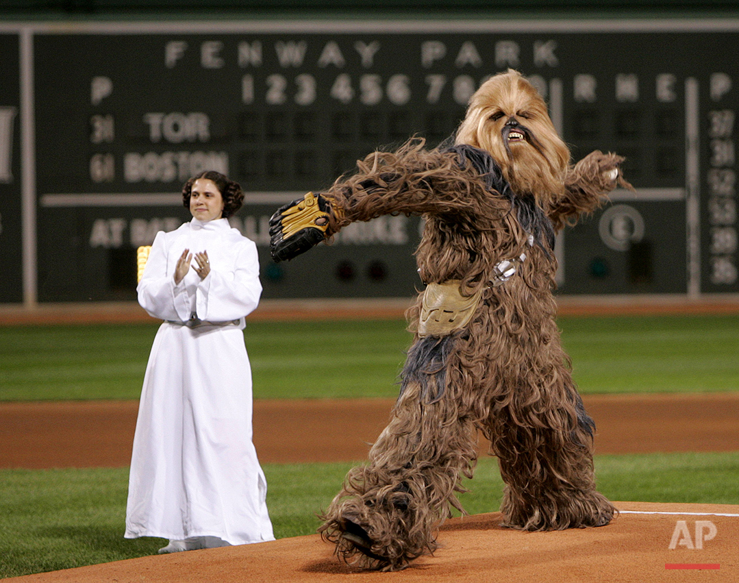 An actor playing Chewbacca throws out the ceremonial first pitch prior to a game between the Boston Red Sox and Toronto Blue Jays Fenway Park in Boston,  Wednesday Sept. 28, 2005. Chewbacca and an actress playing Princess Leia were promoting the Star Wars: Where Science Meets Imagination exhibit at the Museum of Science in Boston. (AP Photo/Charles Krupa)