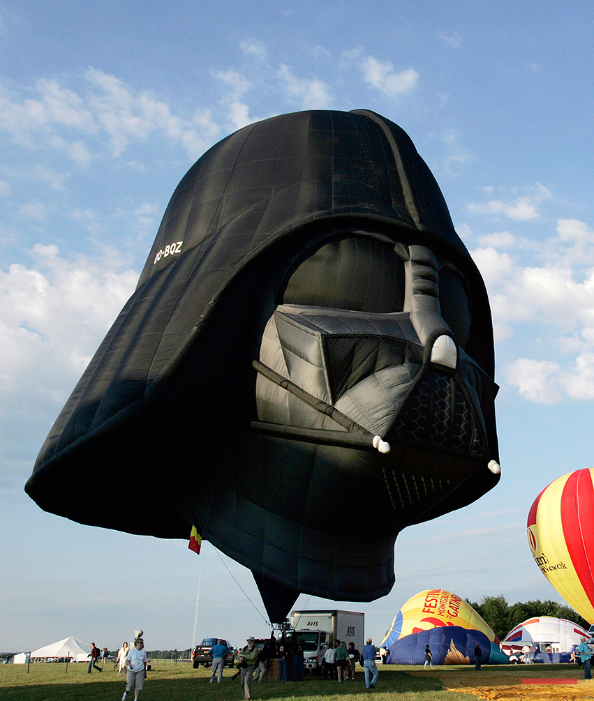 A hot air balloon shaped as the Darth Vader character of the Star Wars movie inflates during the annual Quik Chek New Jersey Festival of Ballooning at Solberg Airport  in Readington, N.J., Friday, July 25, 2008. The  hot air ballooning festival continues through Sunday.   (AP Photo/Mel Evans)