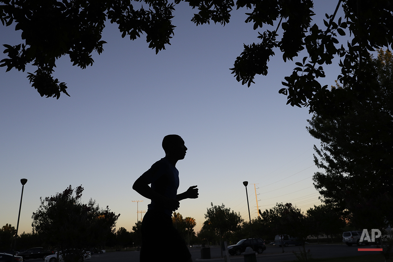 Brien Tillett runs in a park in North Las Vegas on July 12, 2016. A cross country standout, he plans to run on the team when he enrolls in community college in northern California in August. Millennials have edged out baby boomers as the largest living generation in U.S. history, and more than 75 million have come of age. With less than three months to Election Day, the values of young Americans are an unpredictable grab bag. (AP Photo/John Locher)