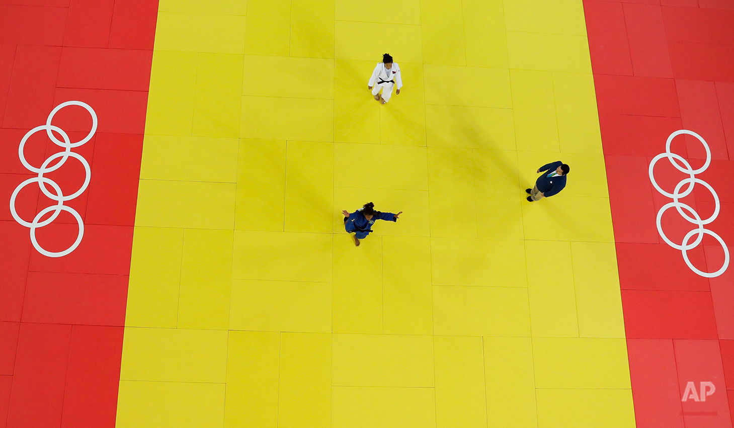 Brazil's Rafaela Silva, blue, reacts after winning the gold medal against Mongolia's Sumiya Dorjsuren, white, during the final of the women's 57-kg judo competition at the 2016 Summer Olympics in Rio de Janeiro, Brazil, Monday, Aug. 8, 2016. (AP Photo/Morry Gash)