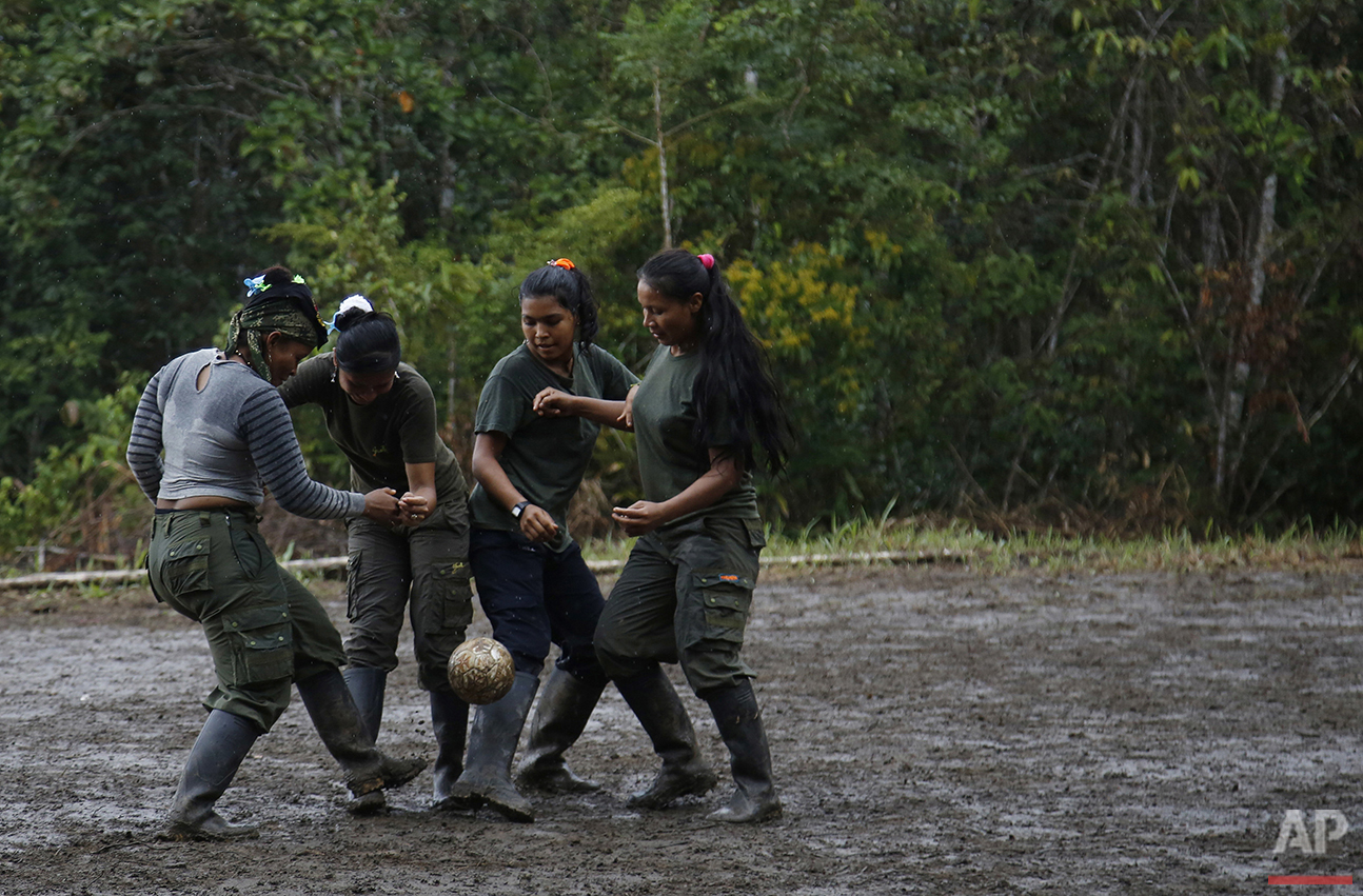 In this Aug. 11, 2016 photo, rebels of the 48th Front of the Revolutionary Armed Forces of Colombia, or FARC, play soccer at their camp in the southern jungles of Putumayo, Colombia. (AP Photo/Fernando Vergara)