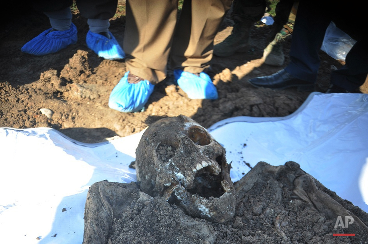 This photo released by the the Mass Graves Directorate of the Kurdish Regional Government shows a skeleton exhumed from a mass grave containing Yazidis killed by Islamic State militants in the Sinjar region of northern Iraq. An analysis by The Associated Press has found 72 mass graves left behind by Islamic State extremists in Iraq and Syria, and many more are expected to be discovered as the group loses territory.  (Kurdish Mass Graves Directorate via AP)