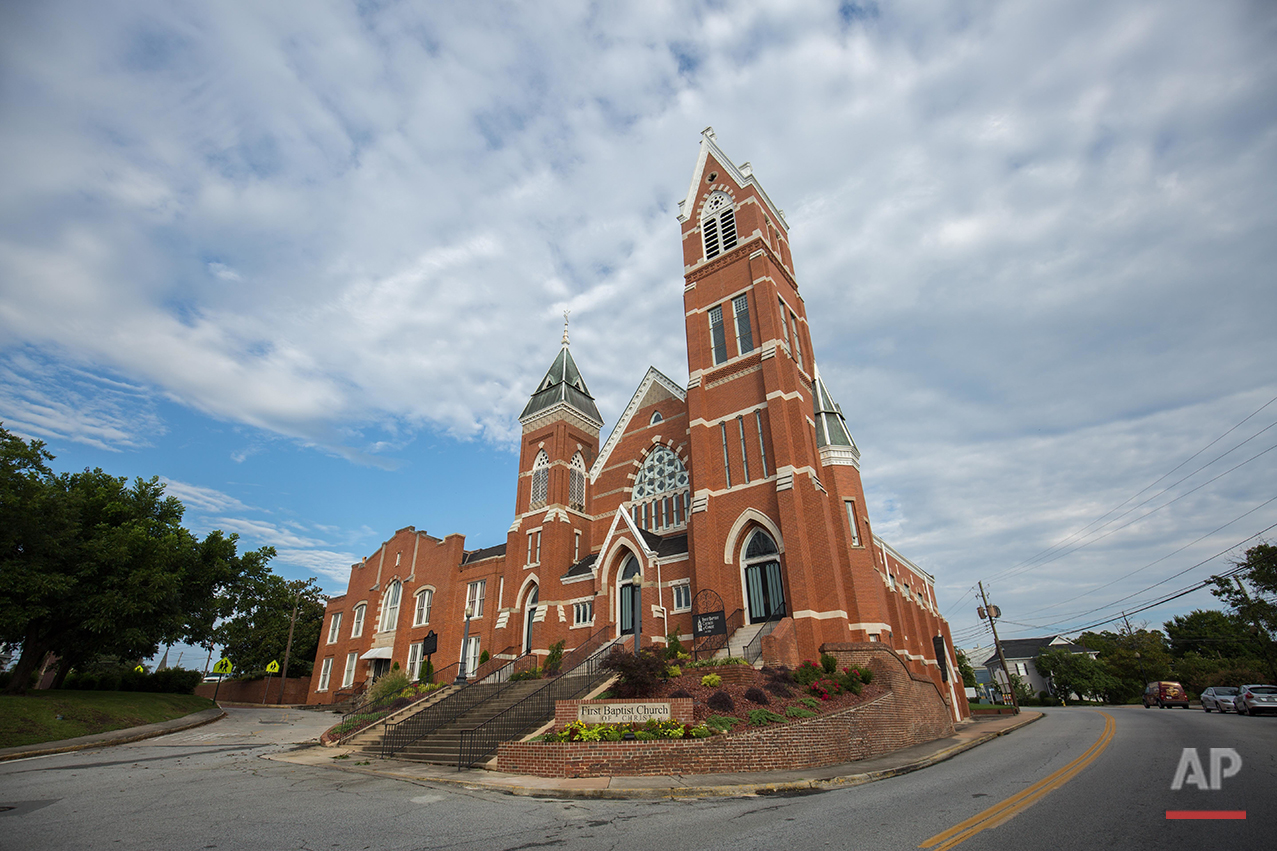 This Sunday, July 10, 2016 photo shows the exterior of the First Baptist Church of Christ, a predominantly white church, in Macon, Ga. In the early 19th century, before the Civil War, whites and blacks often worshipped together, sharing faith but not pews; blacks were restricted to galleries or the back of the sanctuary. Eventually, black populations started growing faster in many communities. Whites, made uneasy by the imbalance, responded by splitting up the congregations. This was apparently the case for First Baptist in Macon. (AP Photo/Branden Camp) See these photos on  APImages.com