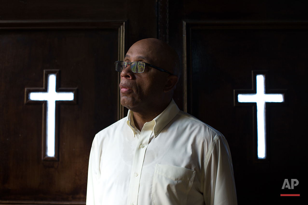 The Rev. James W. Goolsby, Jr. poses for a portrait at the First Baptist Church, a predominantly African-American congregation, in Macon, Ga., on Monday, July 11, 2016. The 59-year-old Atlanta native and graduate of Morehouse College and Mercer's McAfee School of Theology, has been the pastor here for more than 12 years. He said he and a previous pastor at the white church tried to build ties between the congregations but the effort didn't go very far. This time is different, he said, in part because of his relationship with the new pastor, Scott Dickison. (AP Photo/Branden Camp)