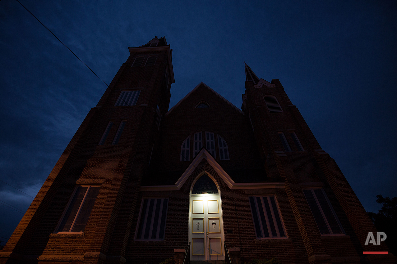 This Monday, July 11, 2016 photo shows the First Baptist Church, a predominantly African-American congregation, in Macon, Ga. In the 1840s, whites maintained oversight of the church as required by Georgia law at the time for fear of slave rebellions. But after the Civil War ended in 1865, the white church fully severed ties. (AP Photo/Branden Camp)