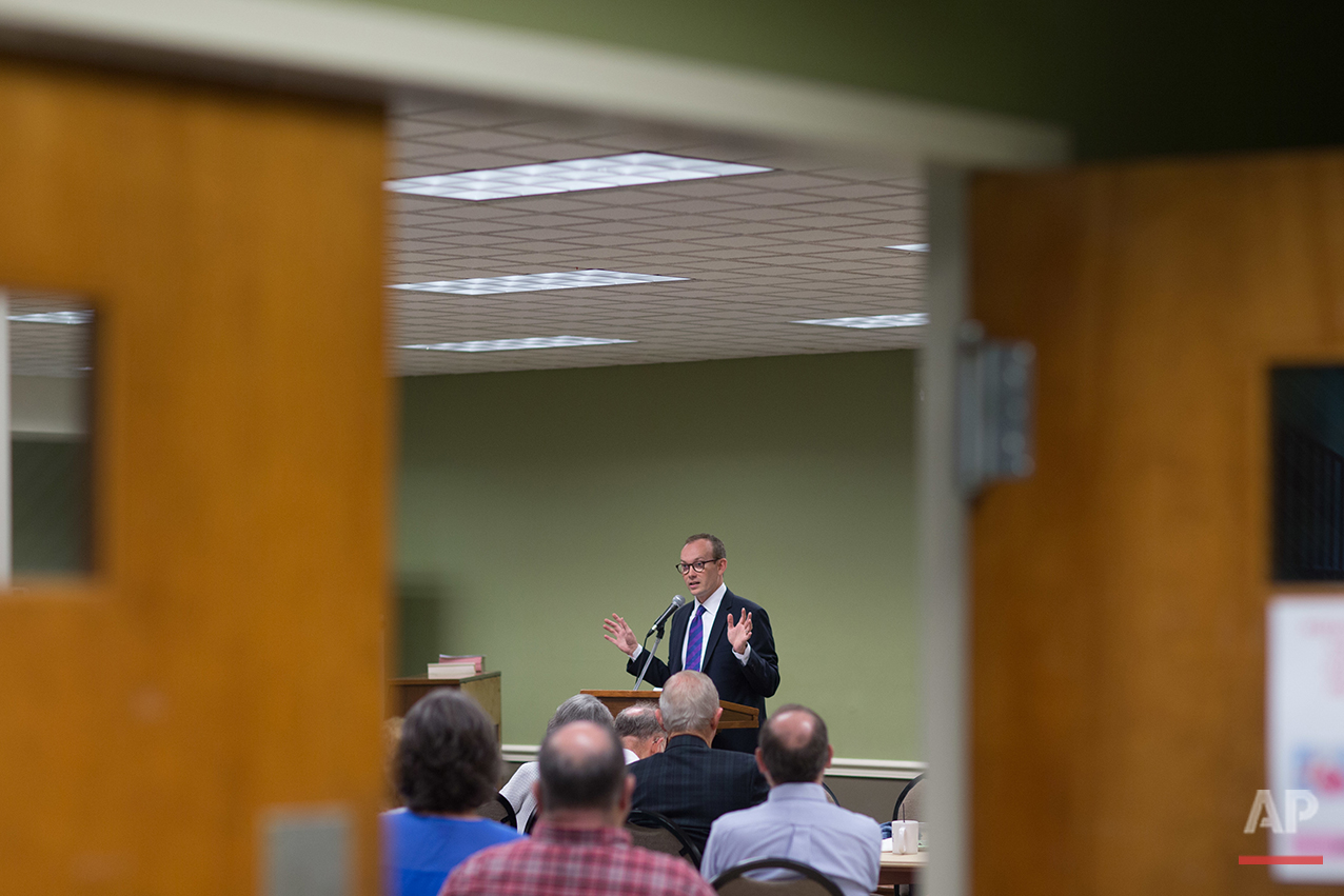 "The Rev. Scott Dickison teaches from a book of sermons by Martin Luther King Jr. during a Sunday School class at the First Baptist Church of Christ, a predominantly white congregation, in Macon, Ga., on Sunday, July 10, 2016 - days after the fatal police shootings of Alton Sterling in Louisiana and Philando Castile in Minnesota, and the fatal ambush on Dallas police. ""It's weeks like these when we need more than ever to be with God's people,"" Dickison told the roomful of congregants. (AP Photo/Branden Camp)"