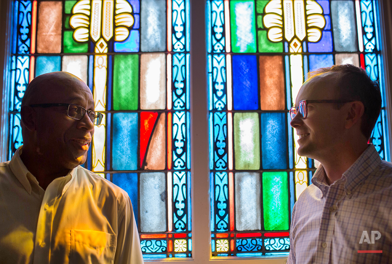 The Rev. James W. Goolsby, Jr., senior pastor of the First Baptist Church, left, and the Rev. Scott Dickison, senior pastor of First Baptist Church of Christ, right, pose for a photo at Dickison's church in Macon, Ga., on Monday, July 11, 2016. There are two First Baptist Churches in Macon _ one black and one white. Two years ago, Dickison and Goolsby met to try to find a way the congregations, neighbors for so long, could become friends. They'd try to bridge the stubborn divide of race. (AP Photo/Branden Camp)