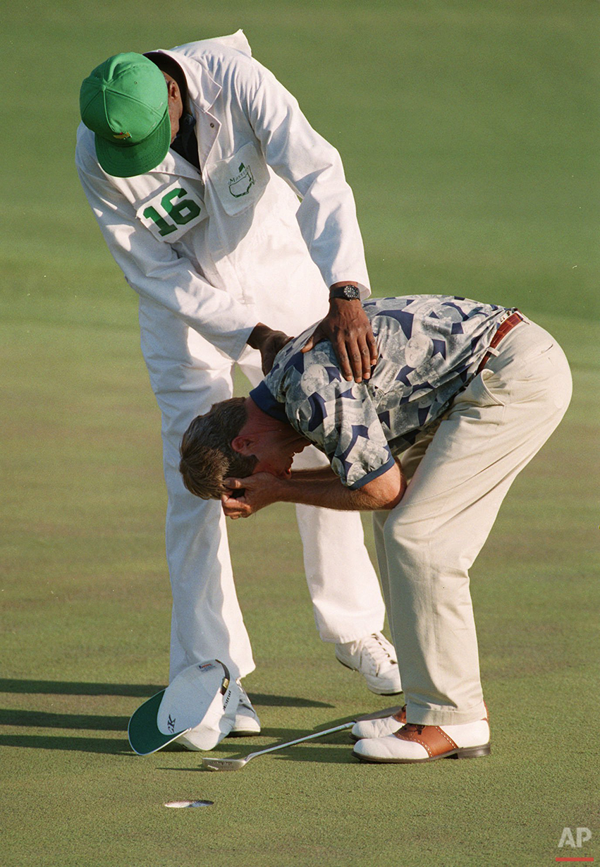 Masters champion Ben Crenshaw is held by caddy Carl Jackson on the 18th as Crenshaw is overcome with emotion as he wins the title at the Augusta National Golf Club in Augusta, Ga. on April 9, 1995. (AP Photo)
