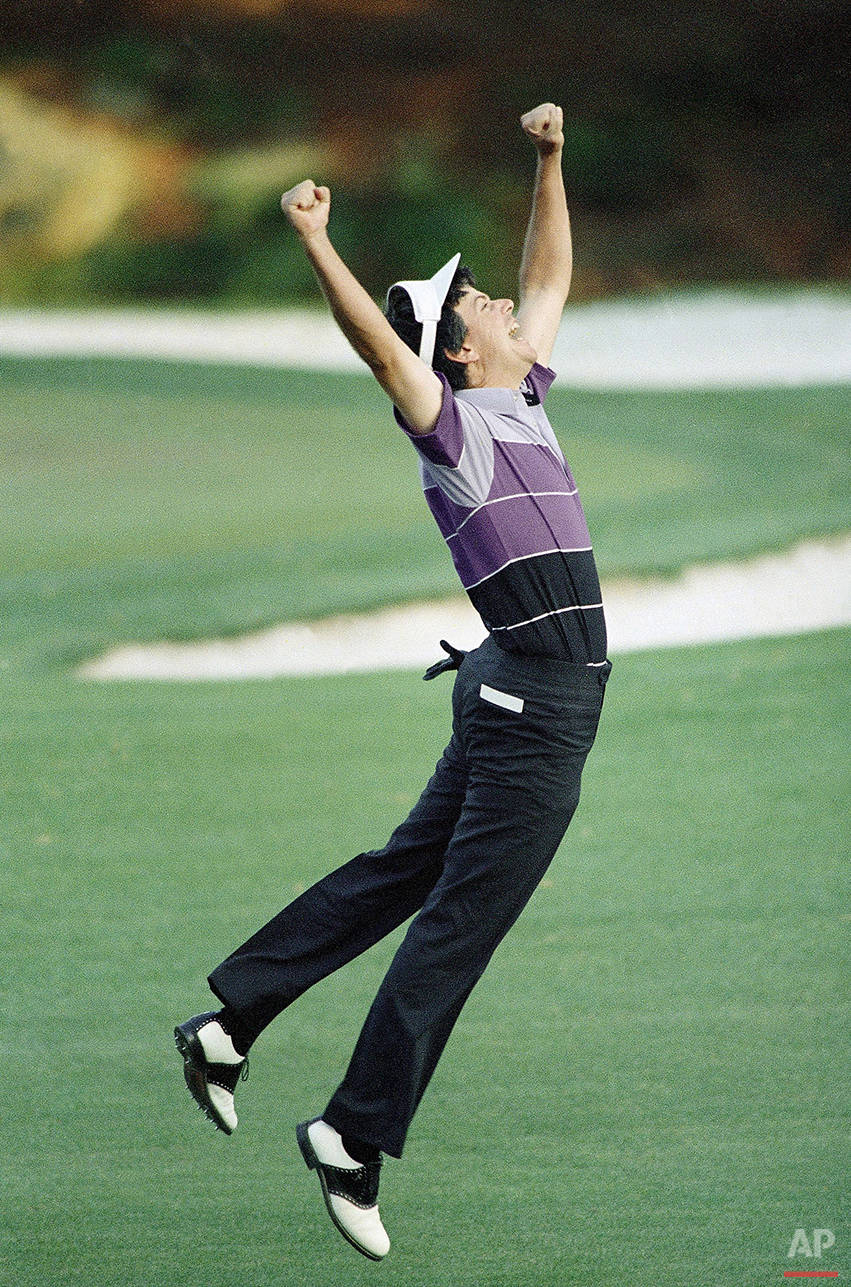 In this April 12, 1987 photo, Larry Mize, of Columbus, Ga., jumps in the air after making the winning shot in a sudden death playoff to win the Masters golf tournament in Augusta, Ga. Mize chipped in for an unlikely birdie to win a playoff. (AP Photo/Joe Benton, File)