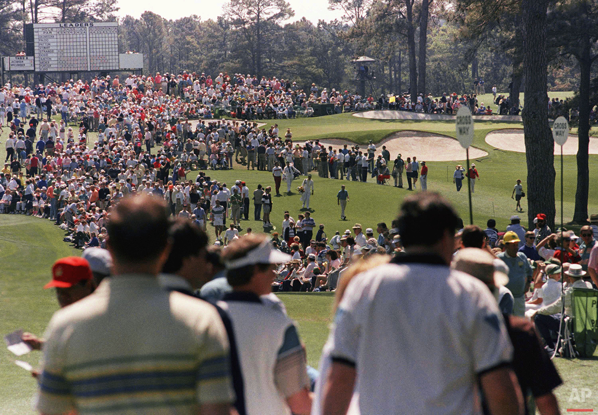 Spectators watch first round Masters play at the Augusta National Golf Club on Thursday, April 5, 1990. (AP Photo/Lou Krasky)