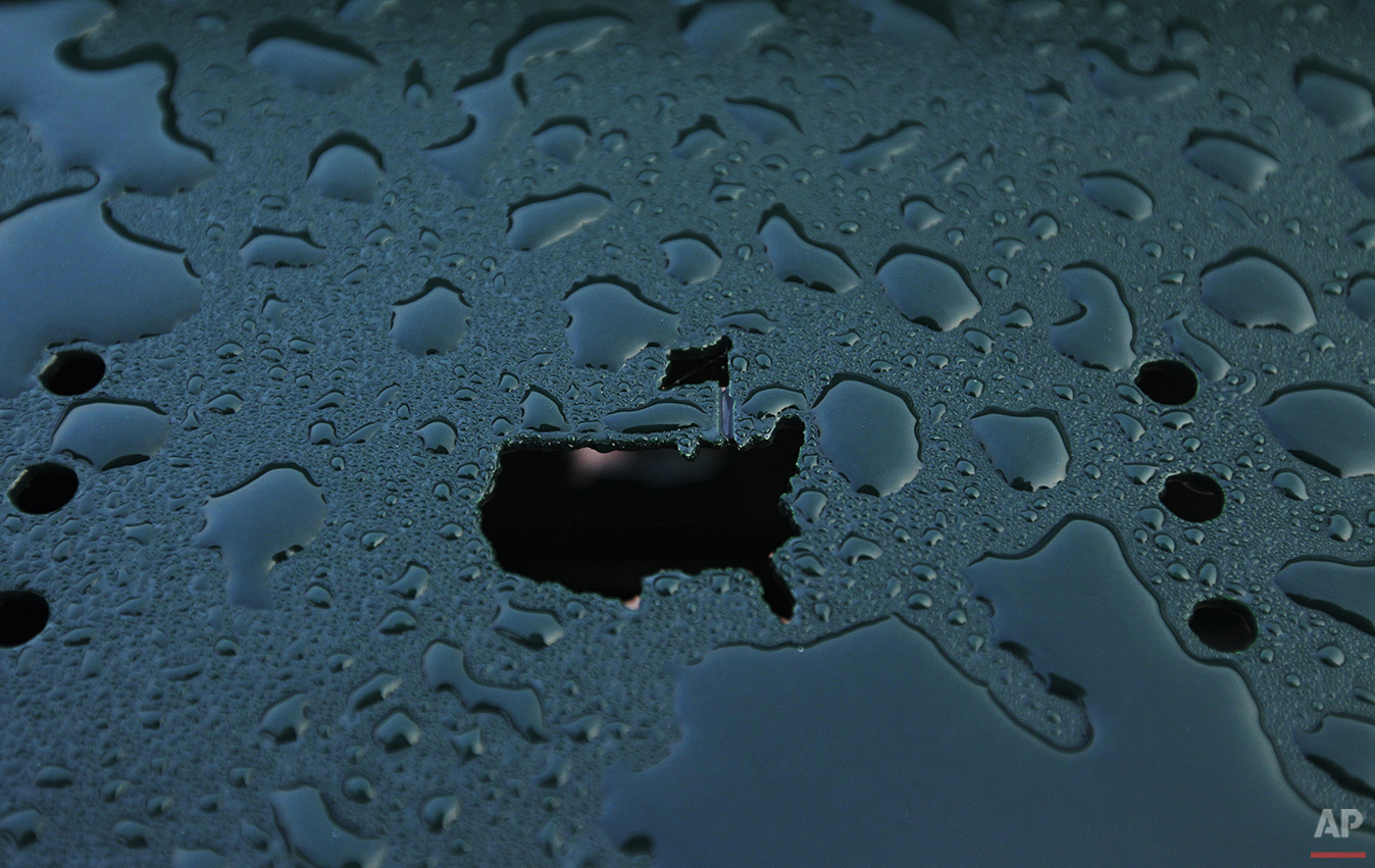 Water drops from an overnight storm surround the Masters logo on a chair at the driving range before practice rounds for the Masters golf tournament Wednesday, April 4, 2012, in Augusta, Ga. (AP Photo/Matt Slocum)
