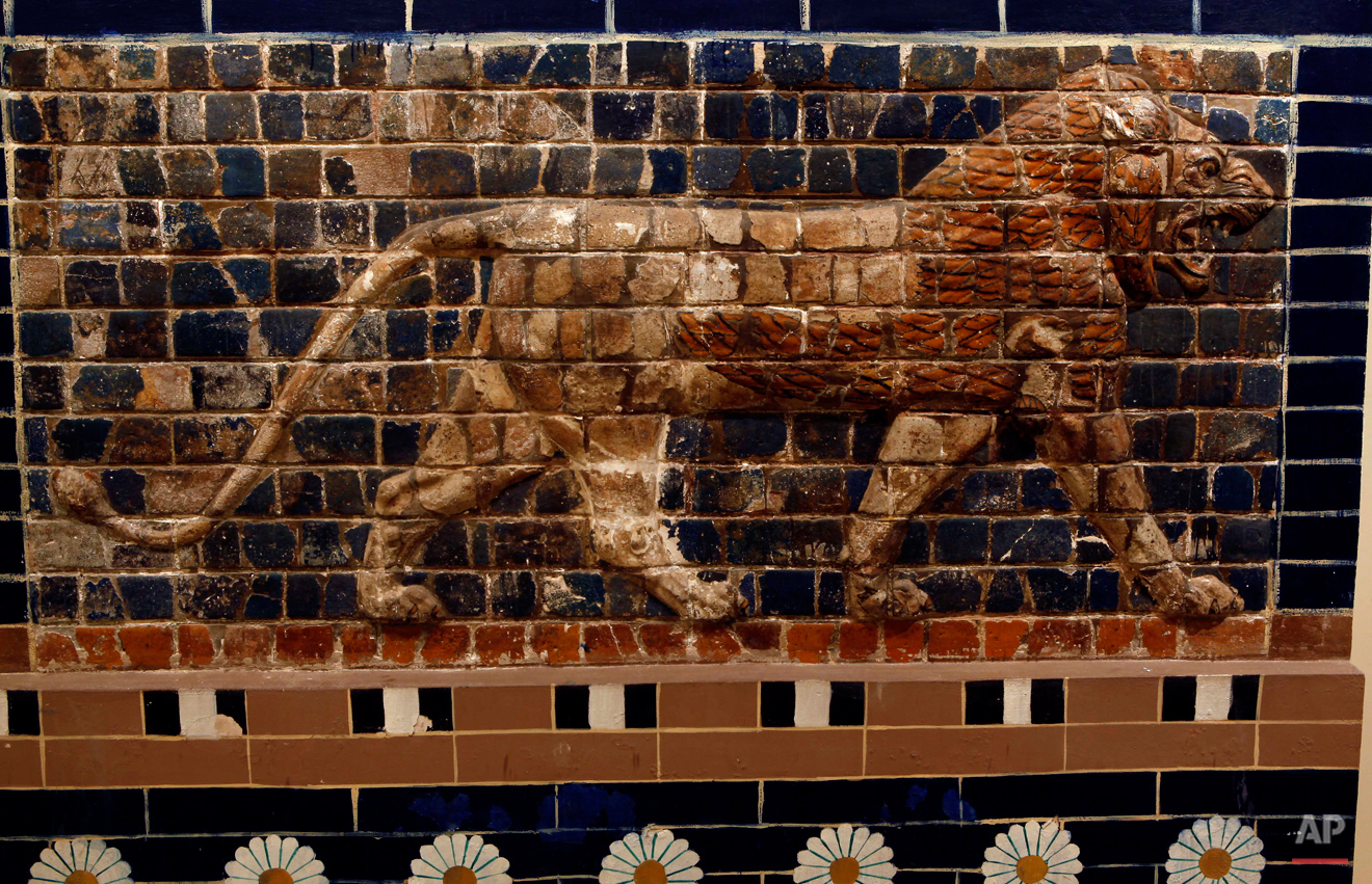 In this Wednesday, April 3, 2013 photo, a panel composed of glazed nicks showing in bas relief a lion, symbolizing Ishtar, the goddess of love and war, from the Ishtar gate, Babylon dating to Nabuchadnessar.(650-562.B.C.) is displayed at the Iraqi National Museum in Baghdad, Iraq. Ten years after Iraqís national museum was looted and smashed by frenzied thieves during the U.S.-led invasion in 2003 to topple Saddam Hussein, it's still far from ready for a public re-opening. Work to overcome decades of neglect and the destruction of war has been hindered by power struggles, poorly-skilled staff and the persistent violence plaguing the country, said Bahaa Mayah, Iraq's most senior antiquities official. (AP Photo/Hadi Mizban)