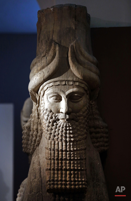 This photo taken on Monday, Sept. 15, 2014, shows a detail of a statue of Lamassu, the great winged bull from the Assyrian period displayed at the Iraq National Museum in Baghdad. After the destruction wreaked on archaeological sites by Islamic State group, the collections at the Iraq's National Museum in Baghdad have become even more important. It's now one of the places you can find relics from ancient cities that fell into the extremists' hands. As many as 4,000 archaeological sites are still under the domination of IS and around 100 sites have been destroyed, according to Iraqi Culture Minister Firyad Rwandzi. (AP Photo/Hadi Mizban)