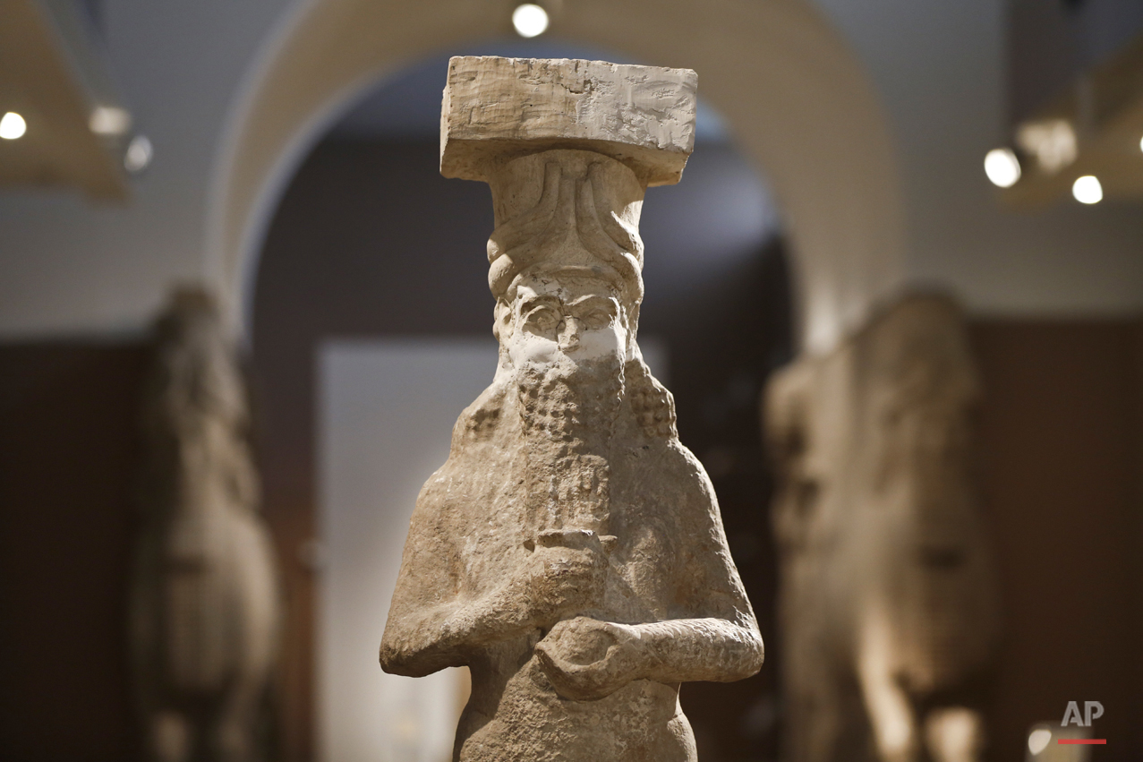 In this Sunday, March 13, 2016 photo, a detail of a figure at the Assyrian Hall of the Iraq National Museum Baghdad. Assyria was a civilization located near the modern-day city of Mosul, now held by the Islamic State group, who published videos online showing the destruction of key Assyrian sites Nimrud and Hatra along with many other religious and cultural sites. (AP Photo/Maya Alleruzzo)